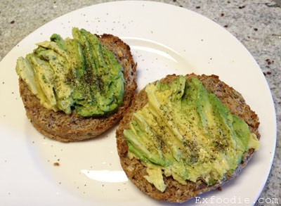 Avocado,kelp flakes on sprouted grain bread